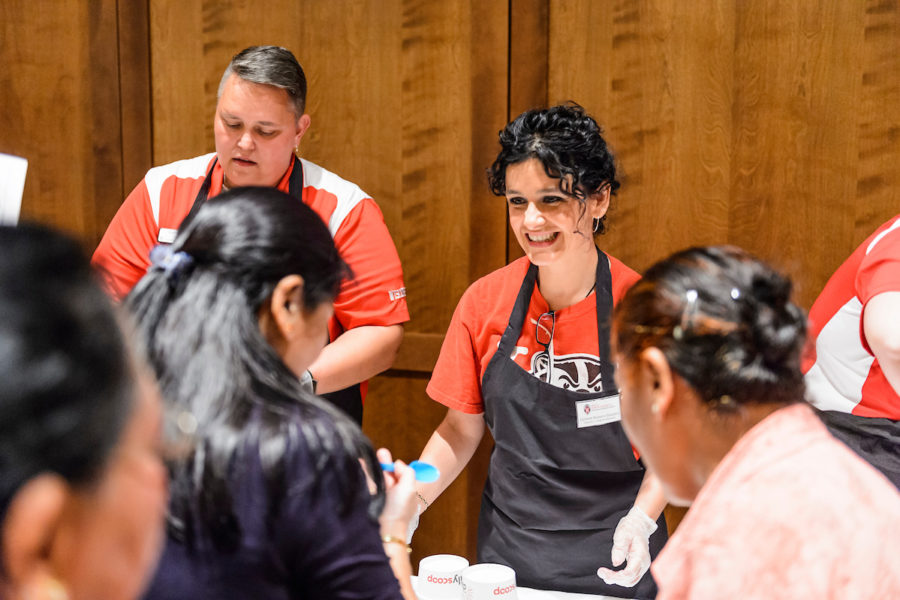 Carmen Romero-Gonzales of the Office of Human Resources, serves ice cream during an employee appreciation ice cream social held for second- and third-shift staff.